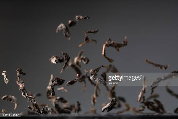 "red tea leaves dancing captured with high speed sync""n - tea leaves stock photos and pictures"