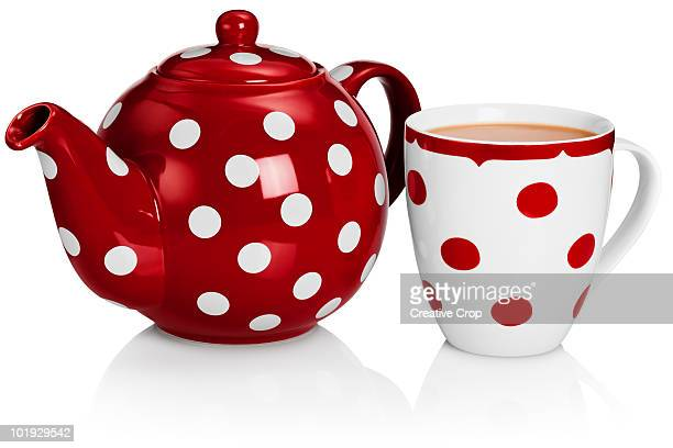 Red tea pot and mug of tea