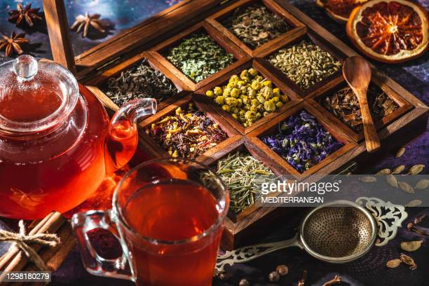 red tea with a box of tea herbs and aromatic spices - brooch stock pictures, royalty-free photos & images