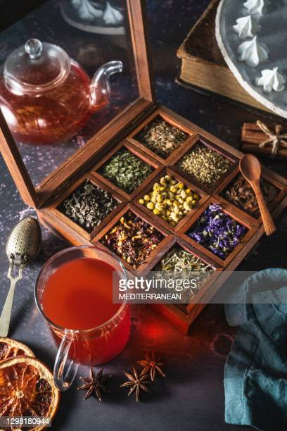 red tea with a box of tea herbs and aromatic spices - mint leaf culinary stock pictures, royalty-free photos & images