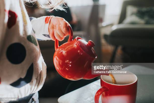 red teapot - water stock pictures, royalty-free photos & images