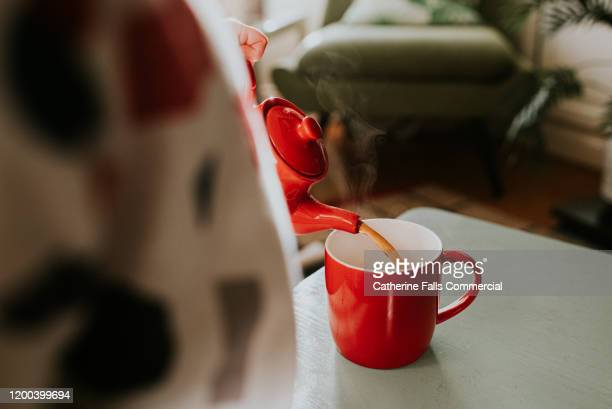 red teapot - making stock pictures, royalty-free photos & images