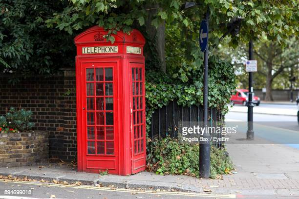 Red Telephone Booth On Footpath