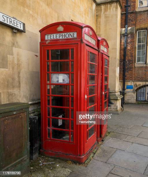 red telephone booth on street - insignia stock pictures, royalty-free photos & images