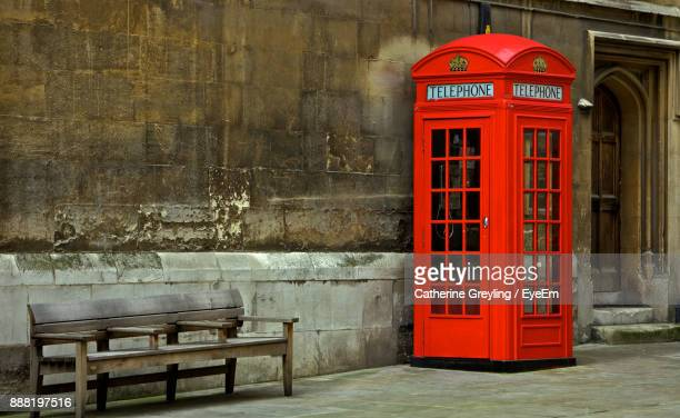 red telephone booth on street - english stock photos and pictures