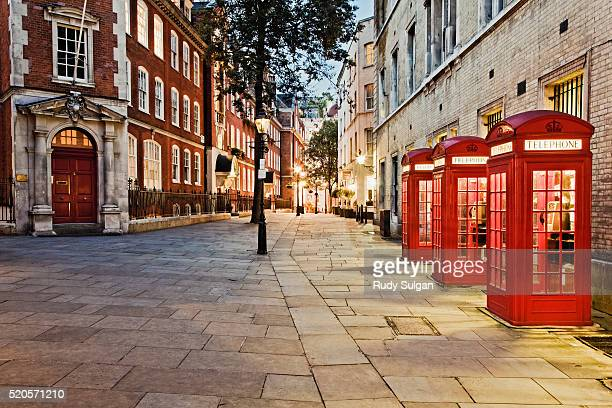 red telephone booths in covent garden - telephone booth stock pictures, royalty-free photos & images