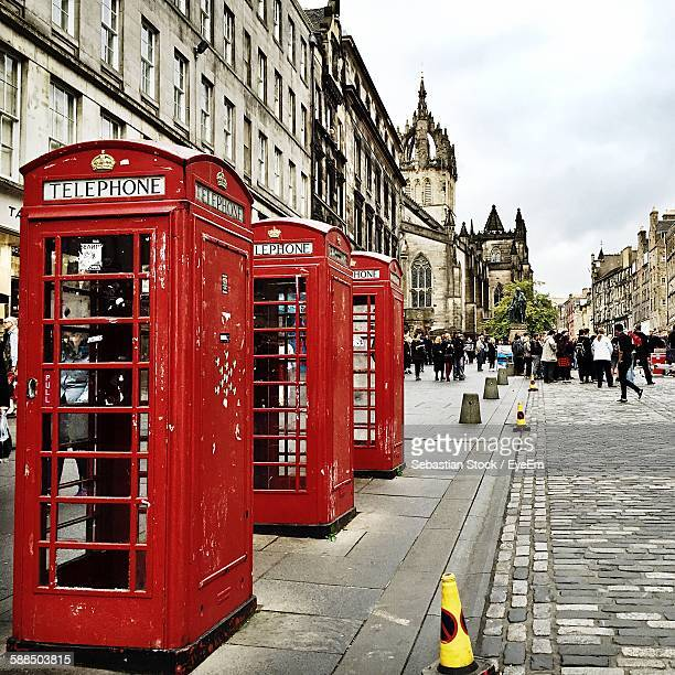 Red Telephone Booths On Sidewalk