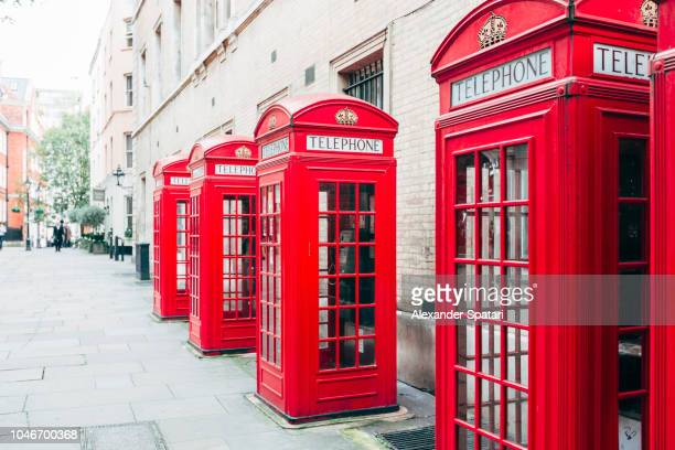 Red telephone booths on the street in London, England, UK
