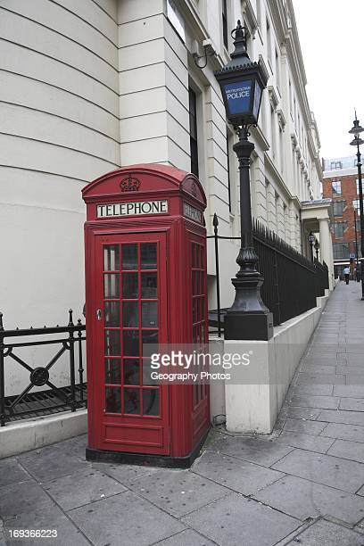 Red telephone box Agar Street outside Charring Cross police station London