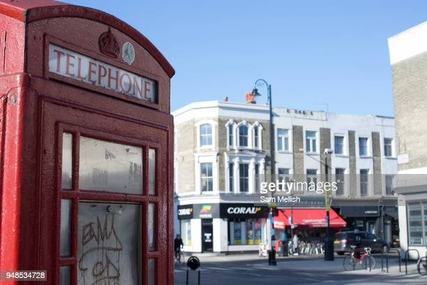 A red telephone box along Golbourne Road on the 26th March 2018 in West London United Kingdom