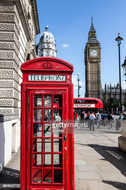 red telephone box and big ben in london - telephone booth stock pictures, royalty-free photos & images