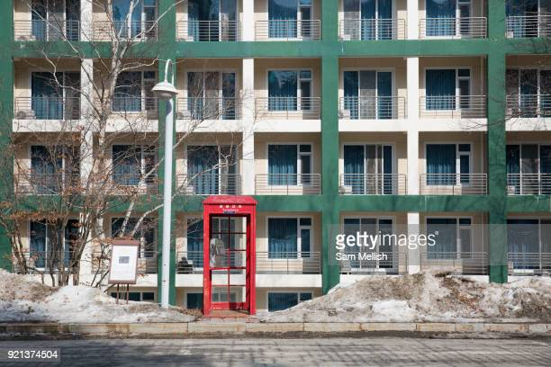 A red telephone box in the afternoon sunlight on February 16th 2018 at the Pheonix Snow Park in Pyeongchanggun South Korea