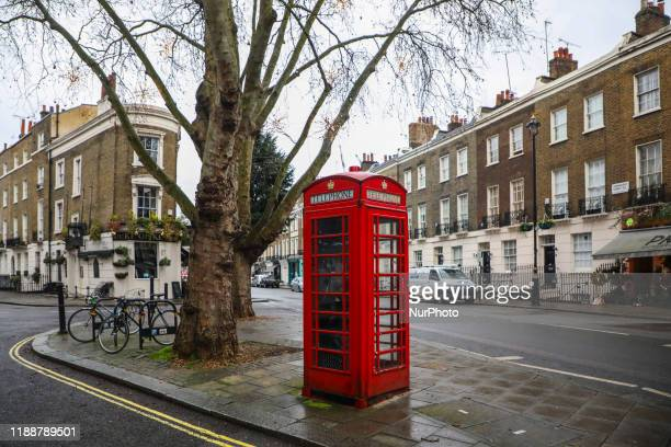 Red telephone box on the street of London United Kingdom on 12 December 2019