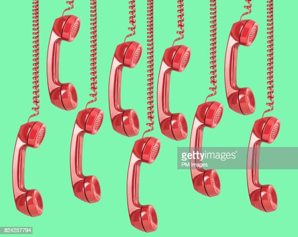 9 red telephone receivers