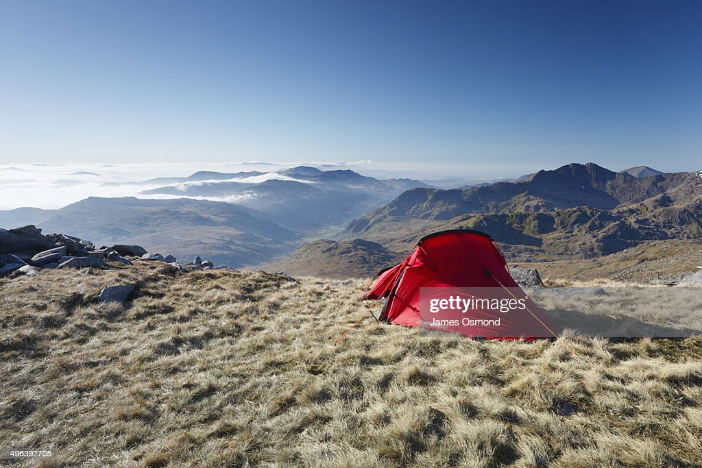 Red tent on mountain side.  Stock Photo & Red Tent On Mountain Side Stock Photo | Getty Images