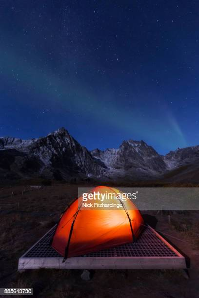A red tent under the stars at grizzly Lake campground, Tombstone Territorial Park, Yukon territory, Canada