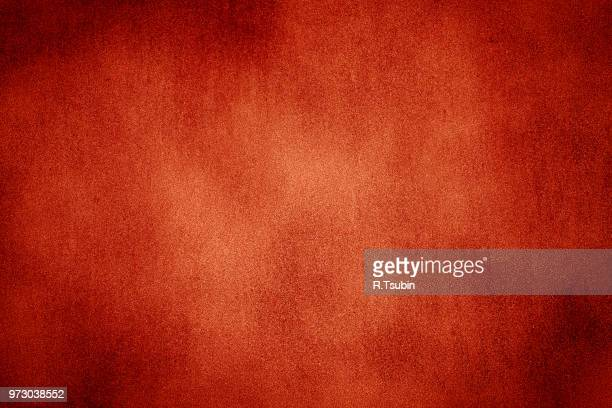 Red texture background with bright center spotlight