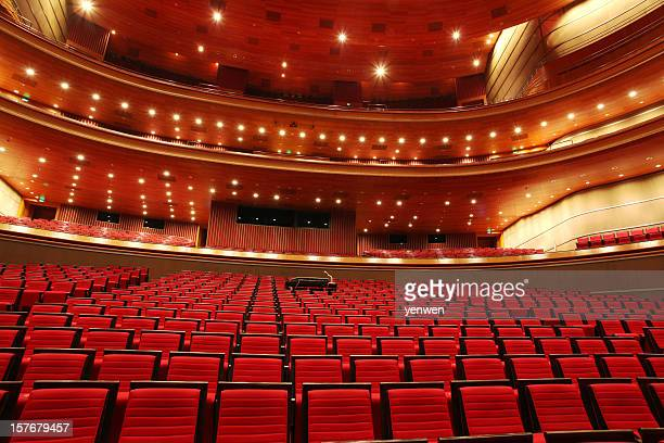 red theater seats - concert hall stock pictures, royalty-free photos & images