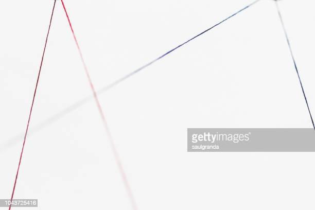 red thread and blue thread against white - thread stock pictures, royalty-free photos & images
