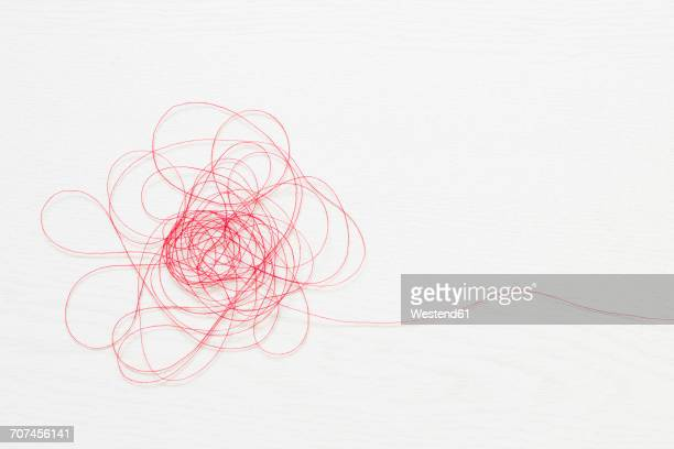 Red thread on white background