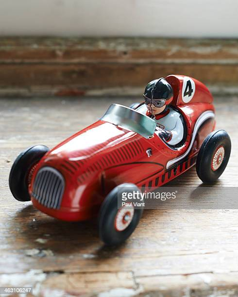 Red tin toy racing car