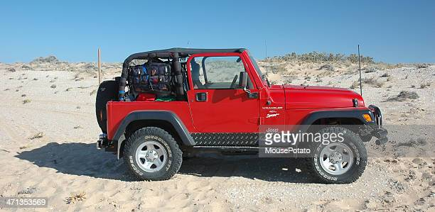 red tj jeep wrangler driving near the coorong, south australia - jeep wrangler stock photos and pictures