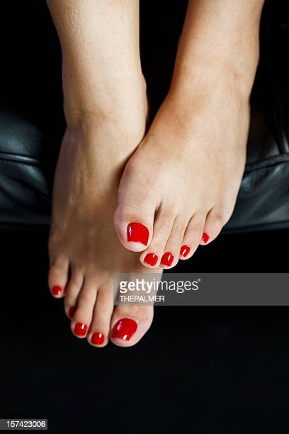 red toenails - beautiful female feet stock photos and pictures