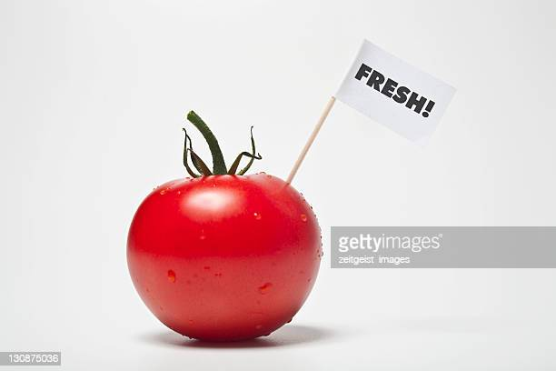red tomato, flag saying fresh! - captions stock photos and pictures