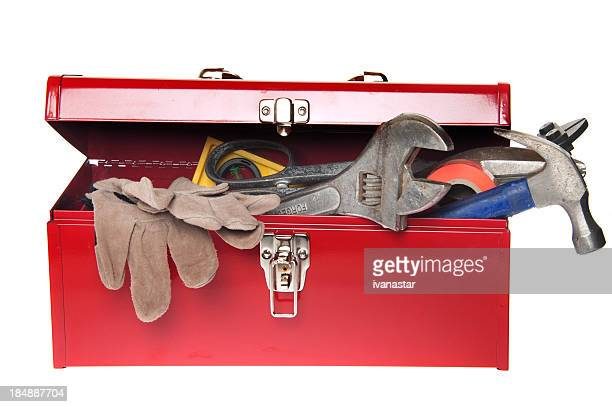 red tool box with variety of tools - toolbox stock photos and pictures