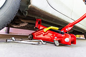red tool jack lift car for Maintenance and service of cars at Car care maintenance