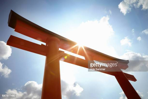 Red Torii Gate Against Blue Sky and sun, Kyoto
