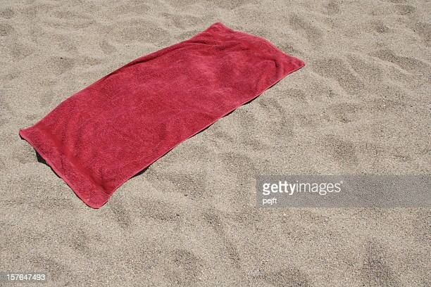 red towel left on sandy beach - pejft stock pictures, royalty-free photos & images