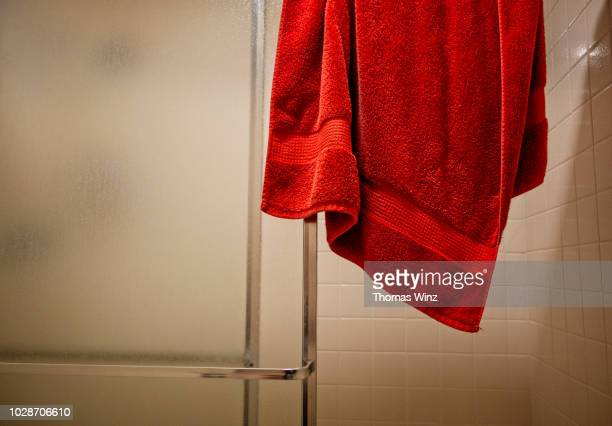 red towel over a shower door - towel stock pictures, royalty-free photos & images