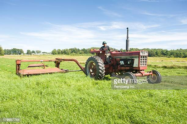 CONTENT] Red Tractor in field cutting grass Brunswick Maine