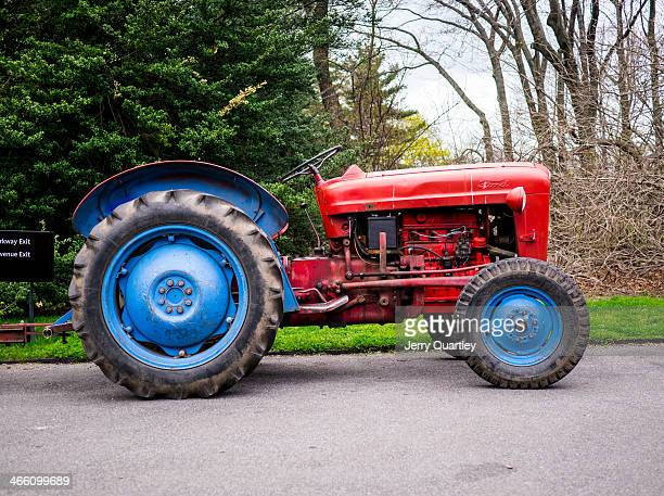 CONTENT] Red tractor with blue wheels in the Brooklyn Botanical Gardens