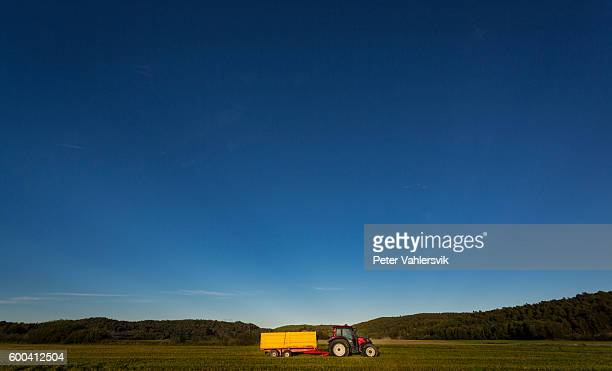 Red tractor with yellow trailer