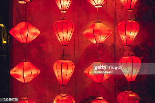 red traditional Chinese paper lantern illuminated at night .