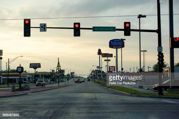 red traffic light and city street at weatherford, oklahoma, usa - stoplight stock pictures, royalty-free photos & images