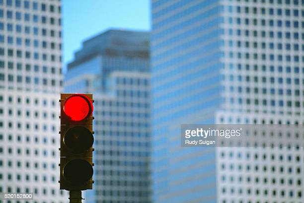 red traffic light and world financial center - red light stock pictures, royalty-free photos & images