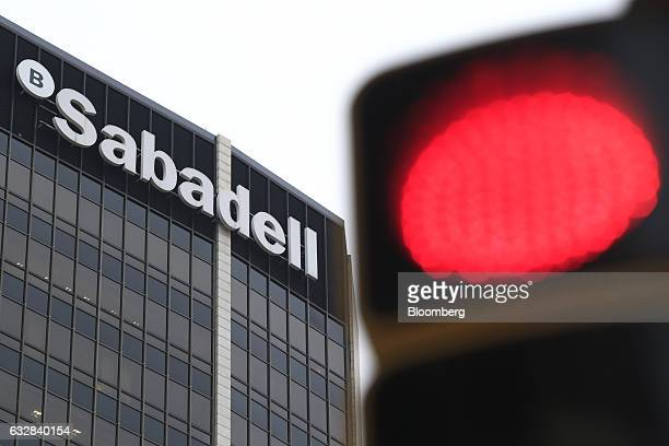 Red traffic light sits outside the headquarters of Banco de Sabadell SA bank in Barcelona, Spain, on Friday, Jan. 27, 2016. Banco de Sabadell SA, the...