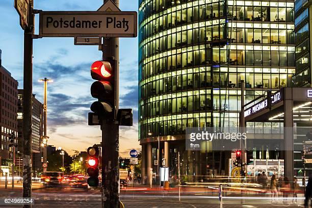 Red traffic light with street sign Potsdamer Platz (Berlin, Germany)