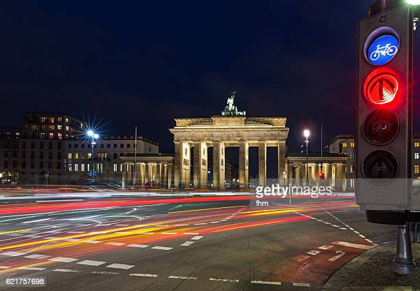 Red traffic lights and light trails at Brandenburger Tor (Brandenburg Gate)