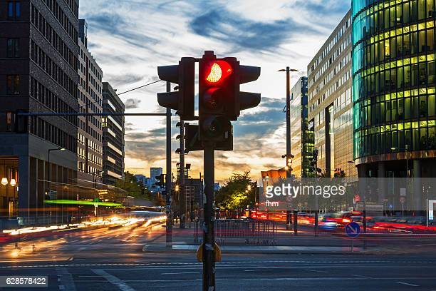 Red traffic lights and vehicle lights at rush hour in Berlin, Potsdamer Platz (Germany)