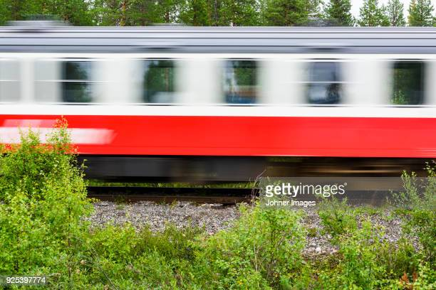 red train in motion - moving past stock photos and pictures