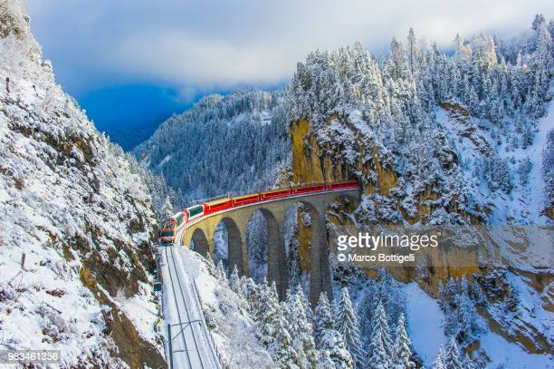 red train in winter wonderland - international landmark stock pictures, royalty-free photos & images