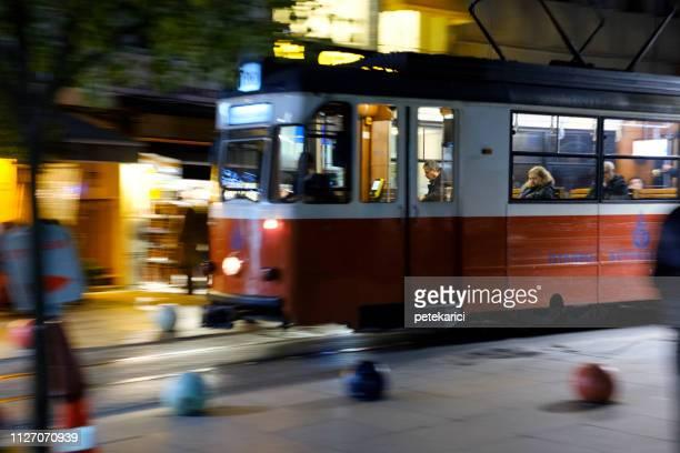 red tram in bahariye street, nostalgic moda tramway, kadikoy, istanbul - kadikoy stock photos and pictures