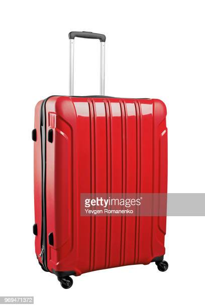 red travel bag isolated on white background. - wheeled luggage stock photos and pictures