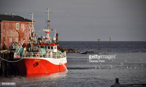 Red trawler at dock