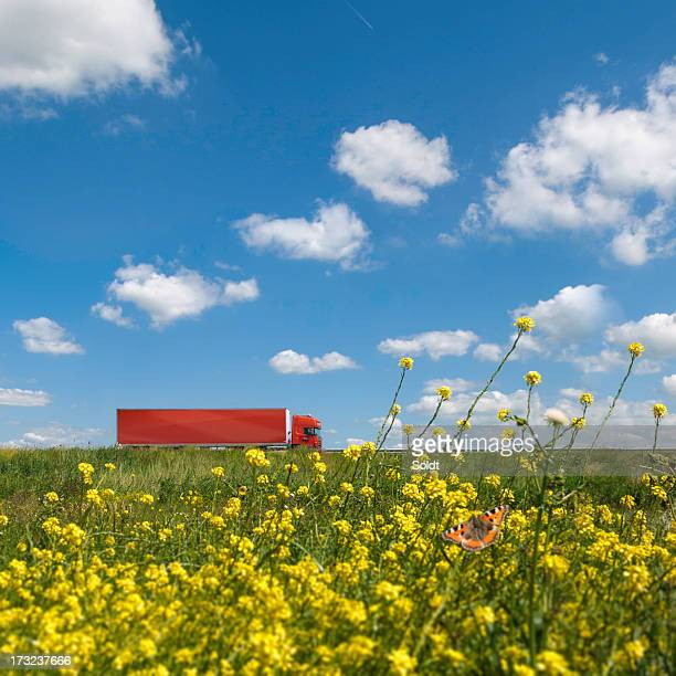 Red truck in dutch landscape