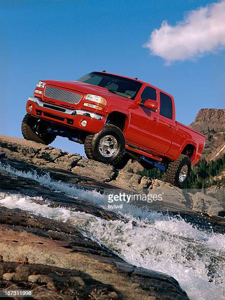 red truck on the rocks - 4x4 stock pictures, royalty-free photos & images